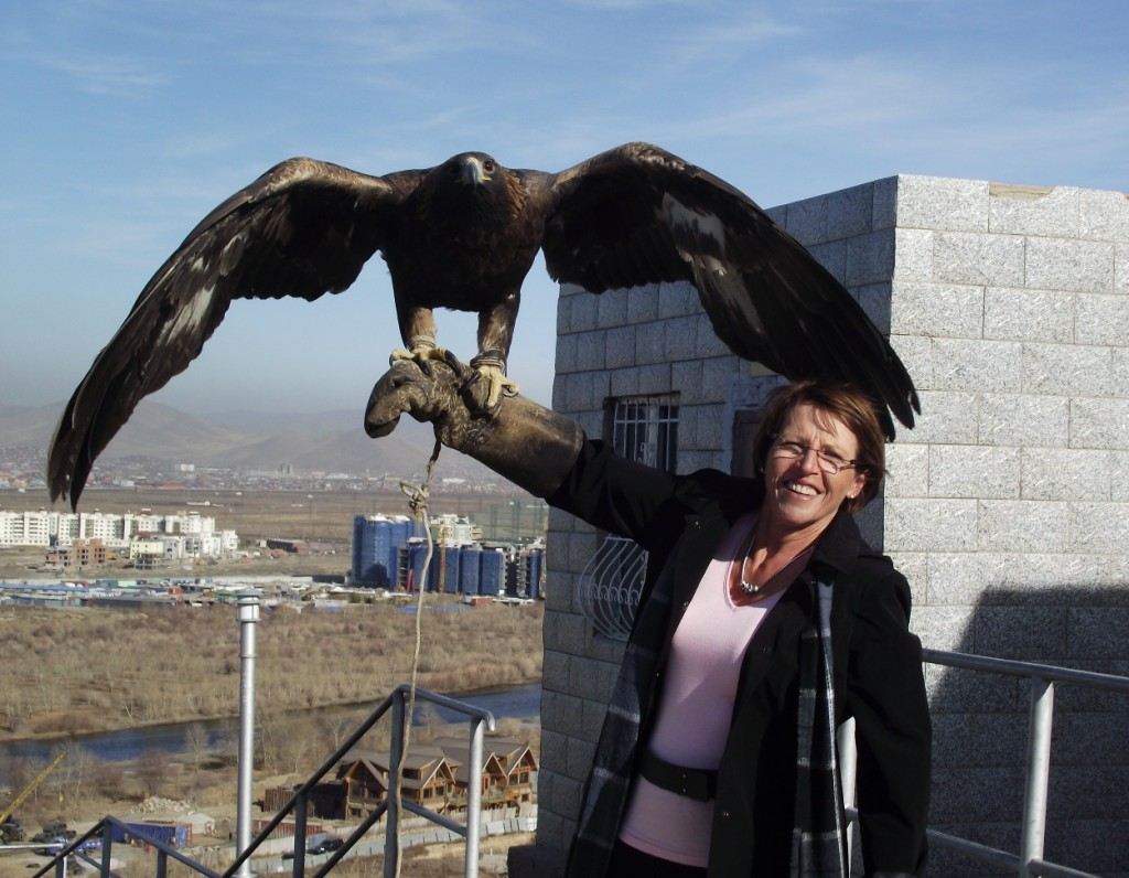 Robyn in Mongolia with an Eagle