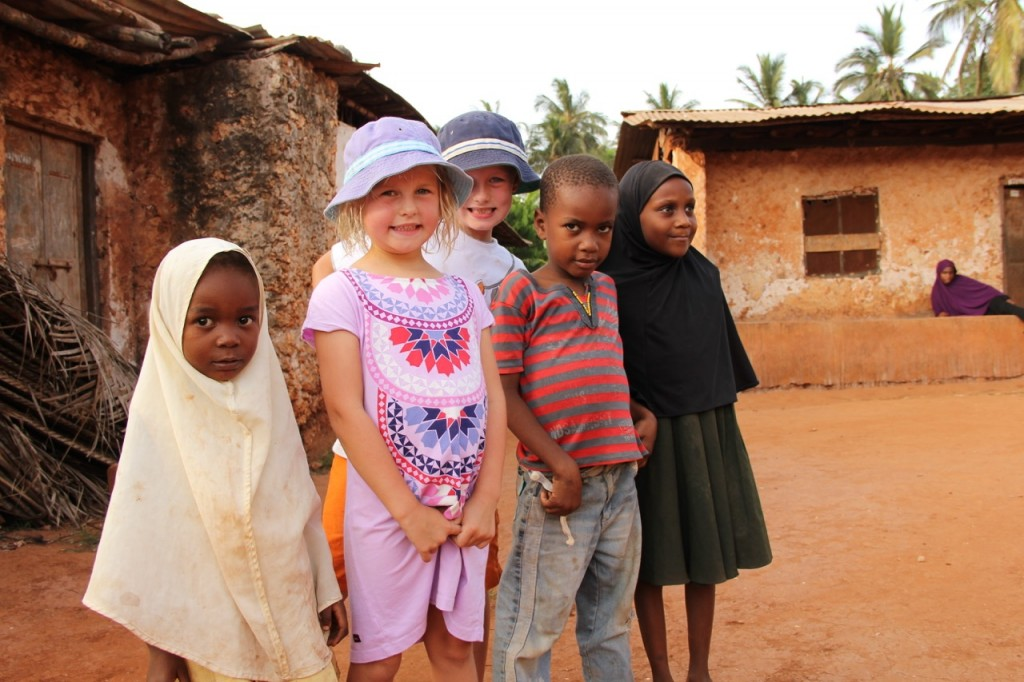 Audrey and Oliver with local kids in Ghana
