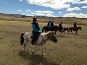 Carolyn riding on the great steppes of Mongolia